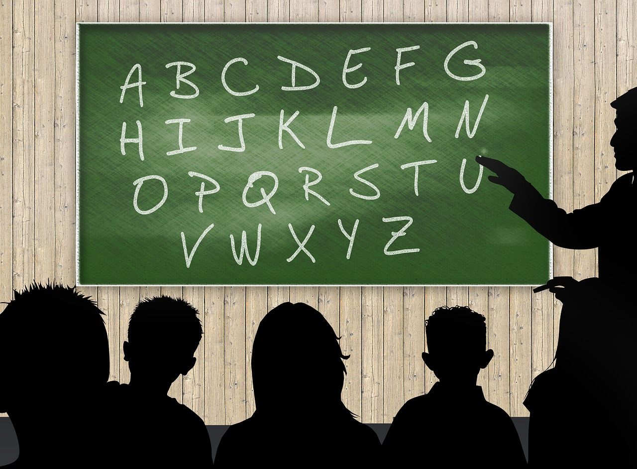 Chalkboard with adults silhouetted in front