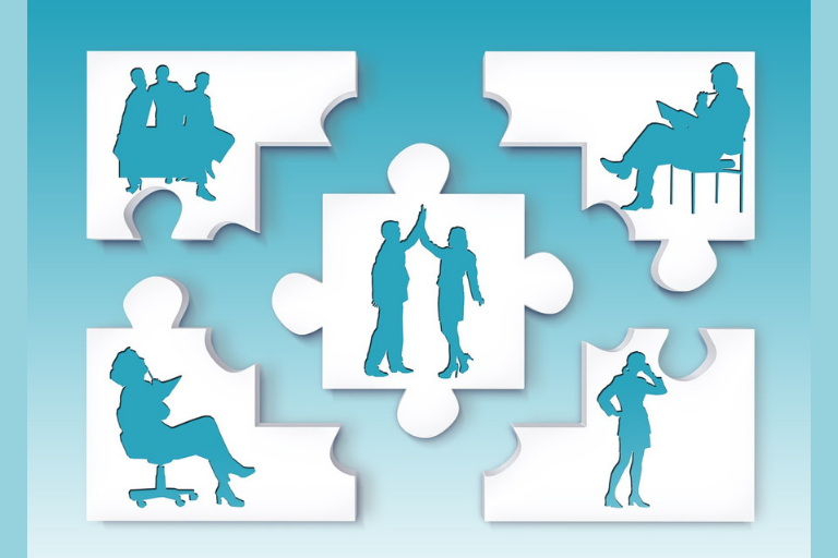 Light blue background with 5 white puzzle pieces showing silhouettes of people working
