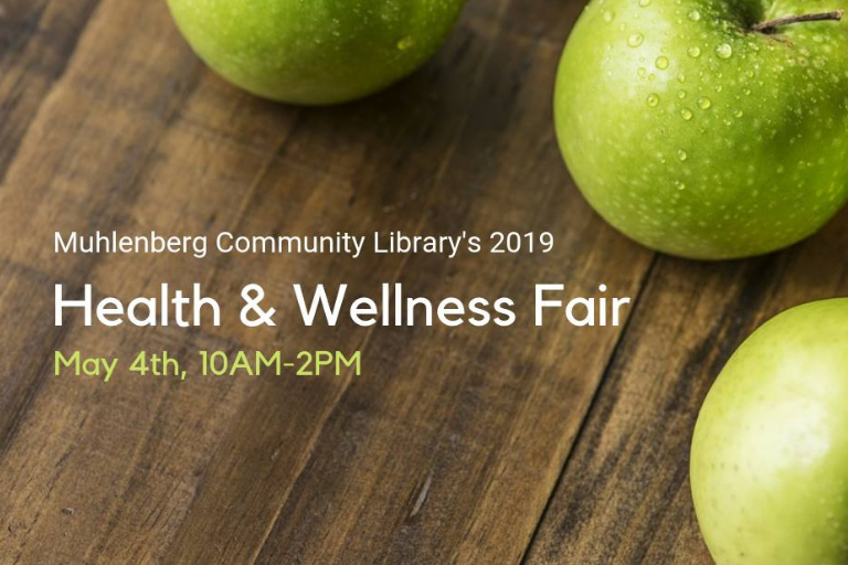 "Green apples on a wooden table with text reading ""Health and Wellness Fair May 4th"""