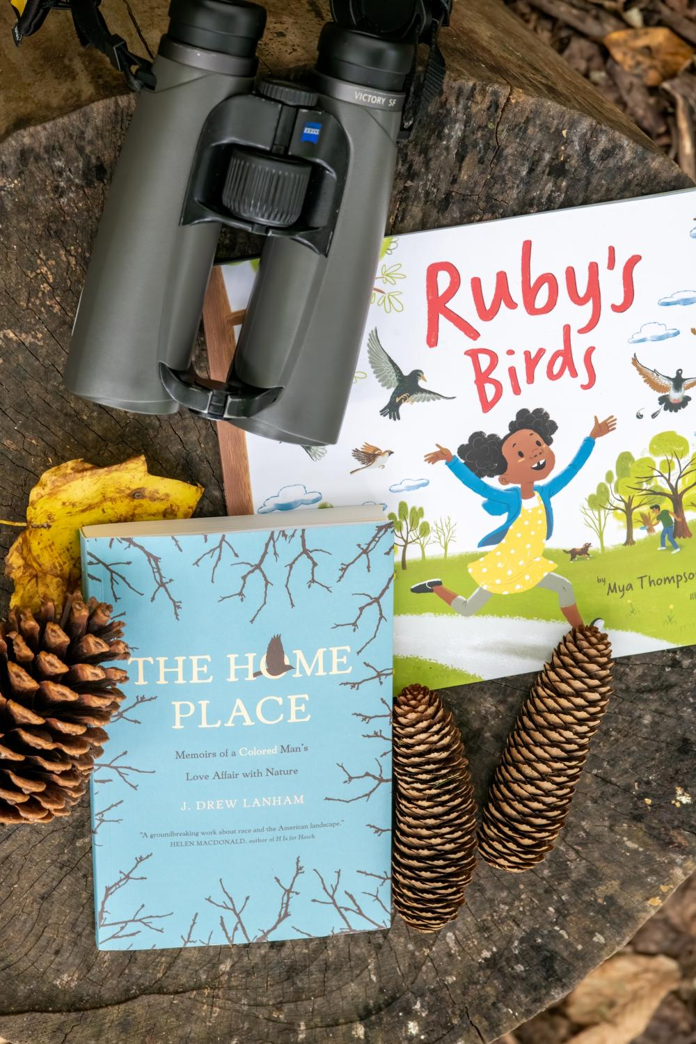 Picture of Ruby's Birds and The Home Place Books in nature with binoculars