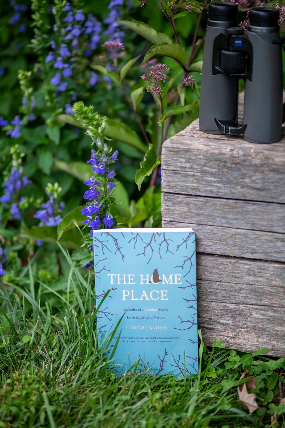 Picture of The Home Place Book in nature with binoculars